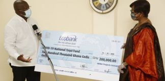 Ebusuapanyin Capt. Paul Forjoe presenting the cheque to Sophia Akuffo