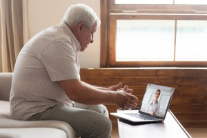 man-doing-telehealth