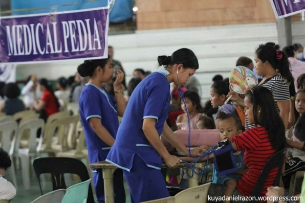 "Volunteer nurses talking to waiting patients and taking vital signs as part of the Standard Operating Procedure of the Free Medical Checkup during the UNTV Action Center ""People's Day"" held in Pasay City last April 25, 2014."