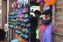 A variety of hats sold by a vendor outside. (The Pokémon drawings definitely caught my attention!)