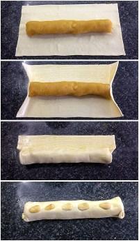 instructie voor het oprollen van het bladerdeeg rond de rol amandelspijs.