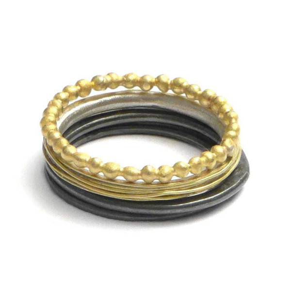 stacking rings black and gold