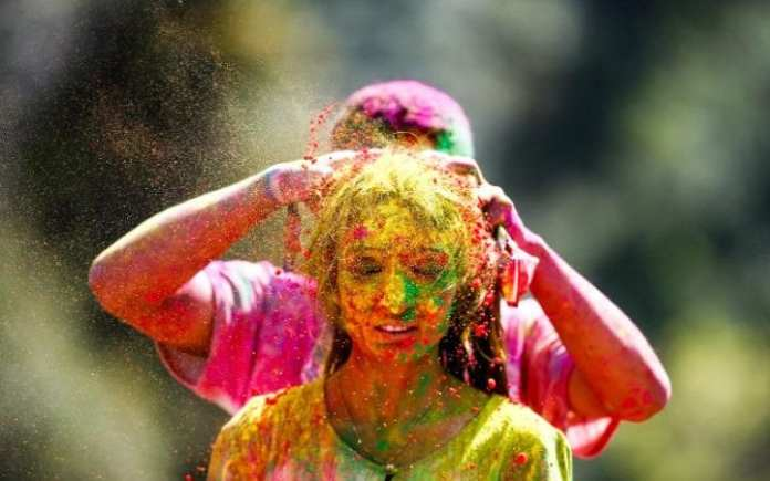 What is the Holi festival and why is it celebrated with colored powder?