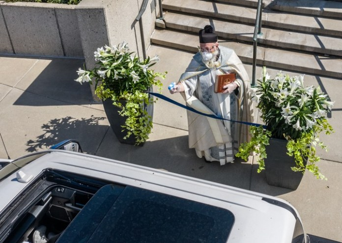 92926213 2573859496164709 7080291623686373376 n Detroit priest goes viral after using water pistol for socially distanced holy water blessing