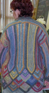 This knitted sweater uses handspun and hand-dyed wool made with all-natural dyes.