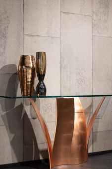 bronze colored vases on elegant table in modern room