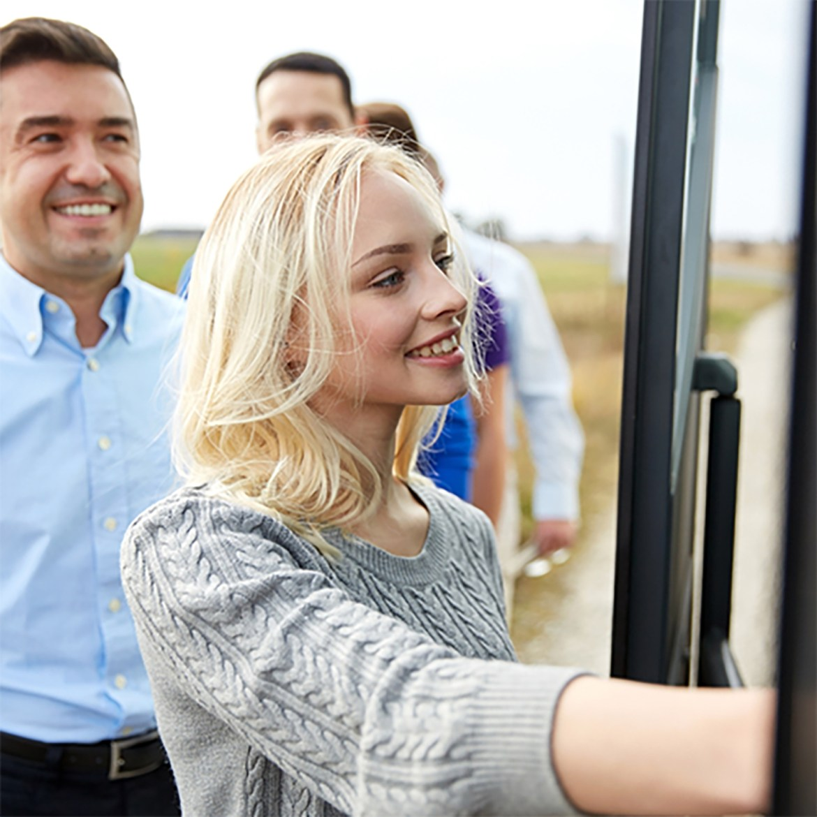 woman boarding a tour bus