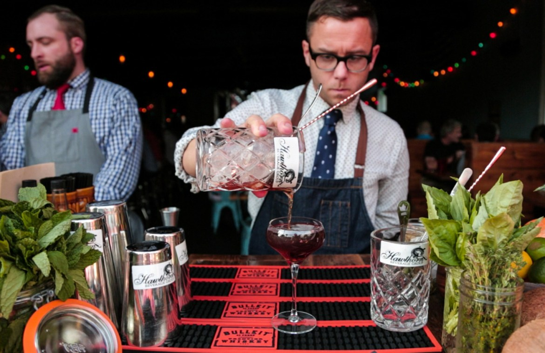 man serving a mixed drink