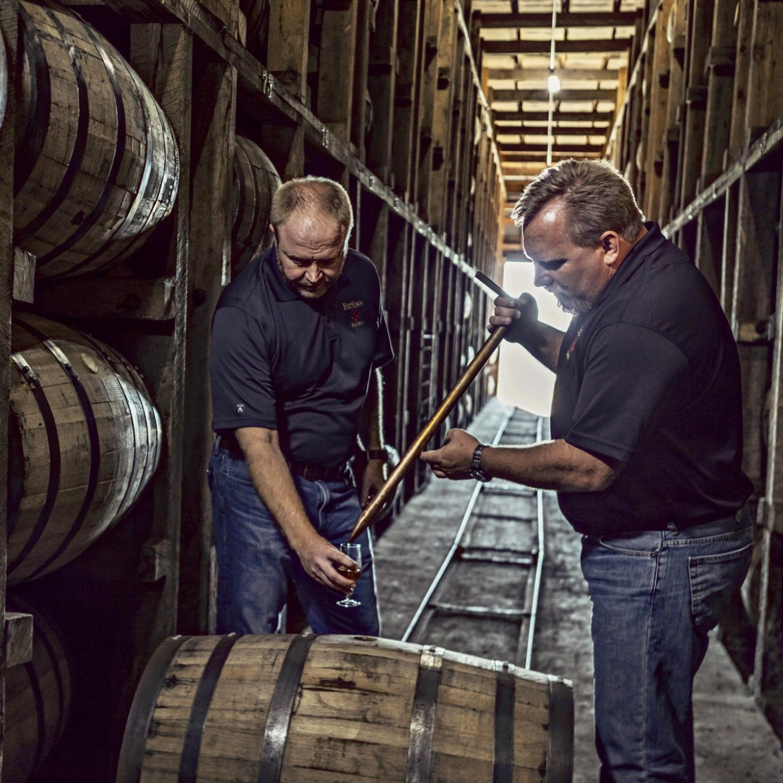 Sampling bourbon from barrels at Four Roses