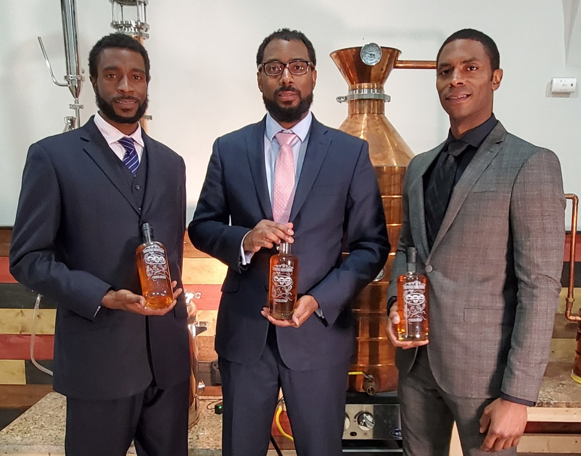 Brough Brothers at distillery scaled - Publications