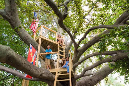 James, Grace, and Rebecca Sikora with dogs Isabella and Sadie, in their treehouse, built into one of the oldest trees in Connecticut. Black Rock, Conn, July 26, 2016. their treehouse, built into one of the oldest trees in Connecticut. Black Rock, Conn, July 26, 2016.