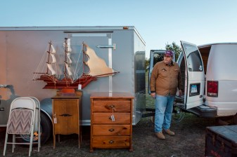 "Chuck Flynn of Shelton, CT, a buyer and reseller who owns Treasures and Things, displays a model ship he hopes will ""sale"" away by the end of the day."