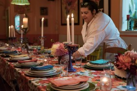 Carol, hostess and head chef, places a centerpiece onto the busy and fun table at The Nook in Black Rock, Conn on Sept. 23 2016.