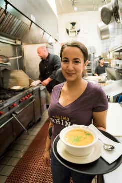 Dominique Angulo, a server at The Blind Rhino in Norwalk, Conn., carries out Chef Jamie's speical Lobster Chowder from the kitchen. May 31, 2016.