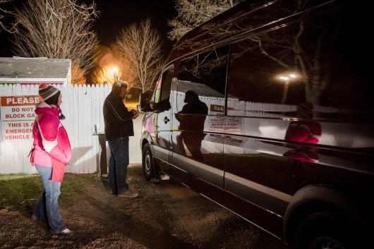 Tanya Wilson and Chris Novello, employees of Elephant's Trunk, oversee admittance to the field. Vendors hoping to sell goods, antiques and oddities arrive and line up well before the gates open at 4:15 am. New Milford, CT on Apr. 10, 2016.
