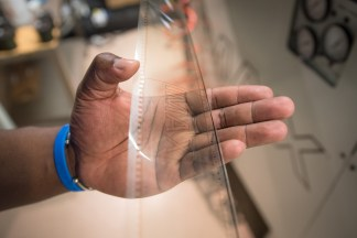 Projectionist Dwayne Blyden holds a frame of 70mm IMAX film that displays the format's logo. Norwalk, Conn on May 4, 2016.