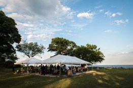 The clambake setup and coastal ambiance on Sheffield Island in Norwalk, Conn on June 30, 2016
