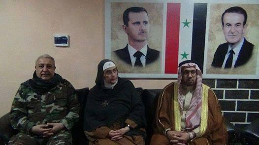Mother Agnes Mariam (centre) pictures with Mihrac Ural (left), a Turkish Alawite who led the NDF forces that slaughtered the Sunni inhabitants of Bayda and Baniyas in the Tartus Province on the coast (October 2013)