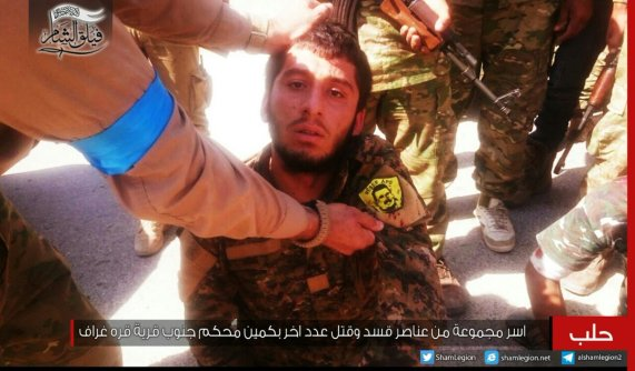 PYD fighter captured by Faylaq al-Sham, 28 AUG 2016. Patch is a picture of PKK's Abdullah Ocalan (