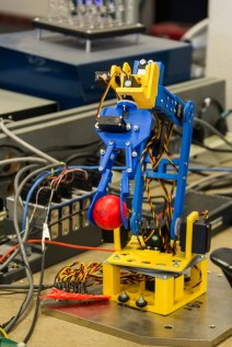 This 3d printed robot arm is designed to manipulate ping pong balls. It uses sophisticated sensors and high precision motors to make fine movements.