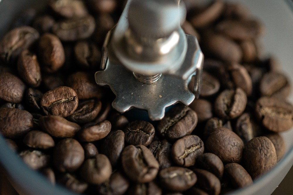 coffee beans in hand grinder from bespoke post