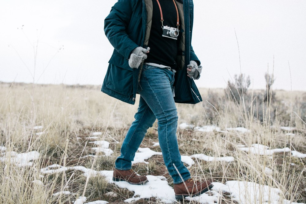 walking through grass and snow in jcrew jeans