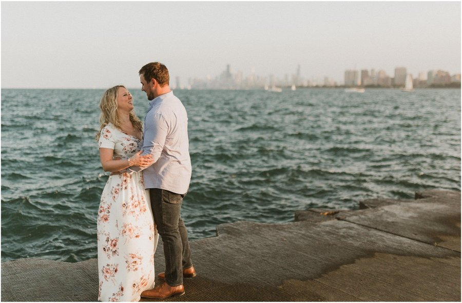 Couple standing along the lakefront