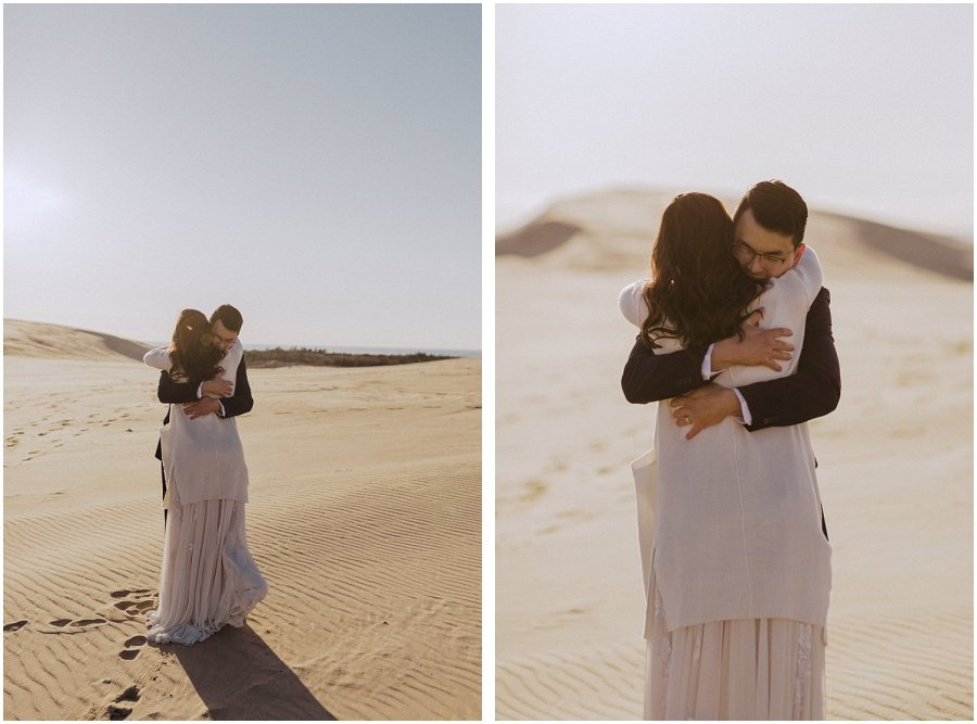 desert inspired elopement couple hugging michigan