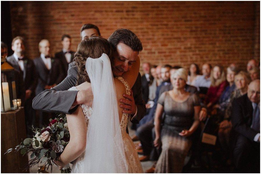 bride's dad giving her a hug