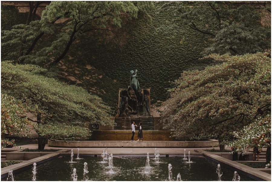 Couple dancing in front of a fountain