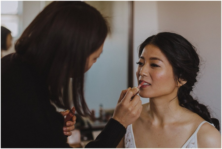 bride getting her makeup put on Chicago wedding photographer kyle szeto