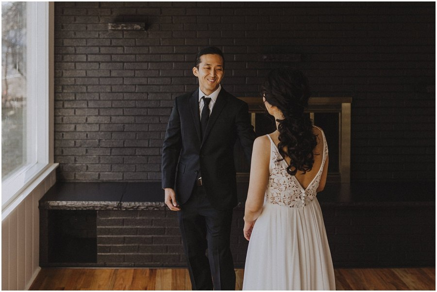 groom and bride during a wedding first look at an in home wedding Chicago wedding photographer kyle szeto