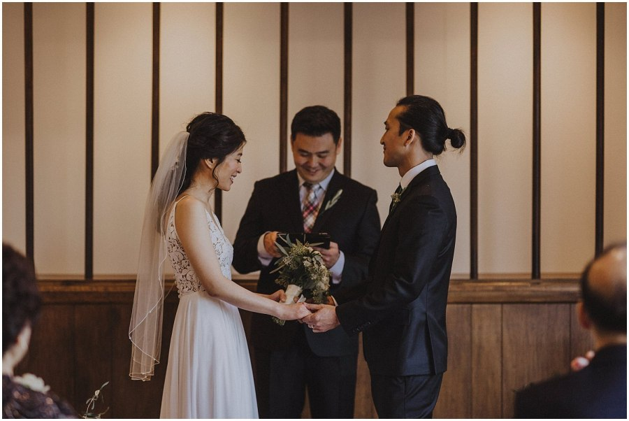 in home wedding ceremony prayer Chicago wedding photographer kyle szeto