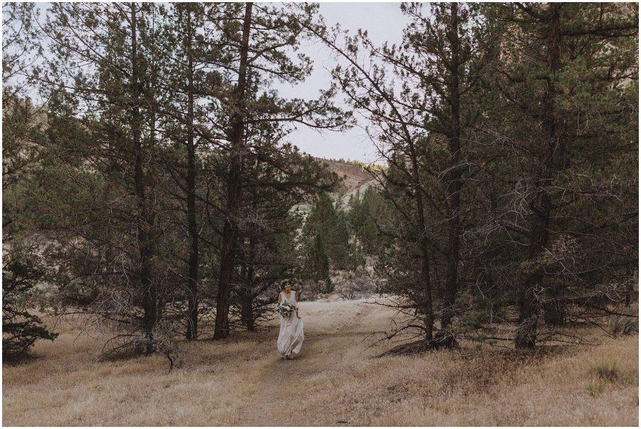bride walking through some trees oregon elopement and wedding photographer kyle szeto