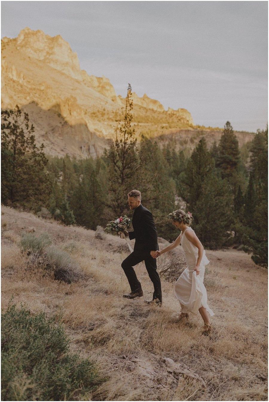 couple walking up mountain oregon elopement and wedding photographer kyle szeto