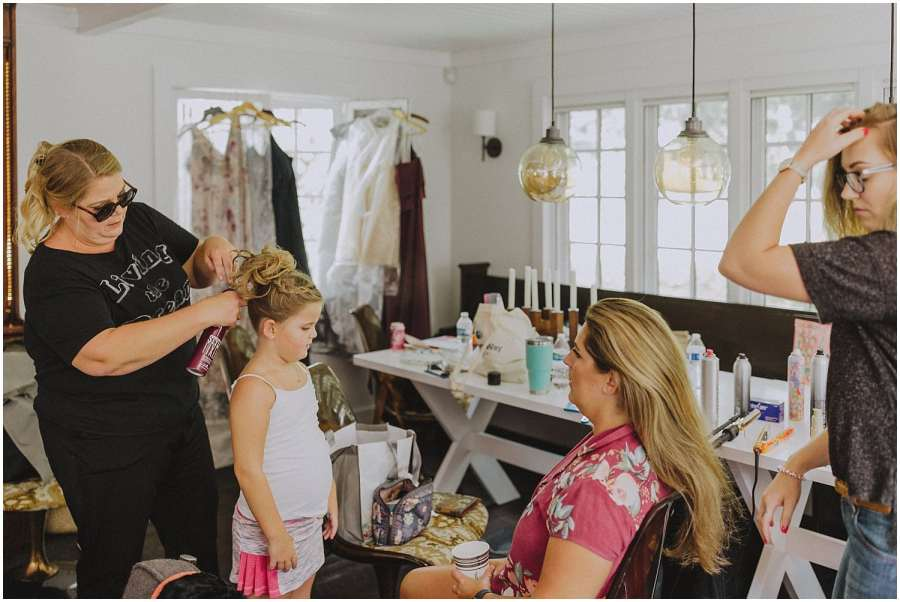flower girl and bridesmaid getting ready wisconsin wedding elopement photographer kyle szeto