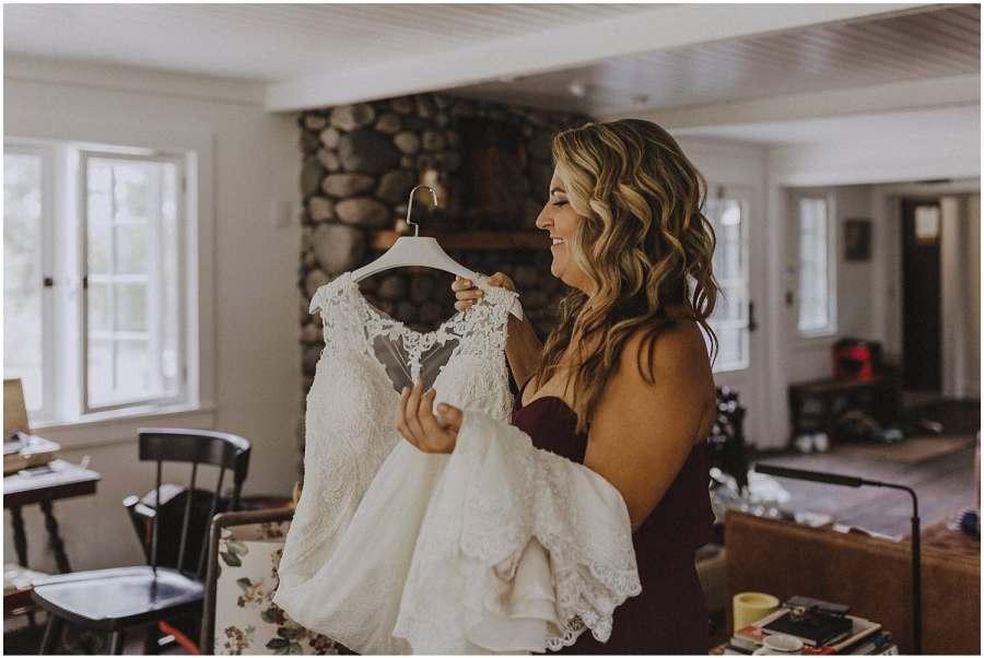 briddesmaid holding wedding dress wisconsin wedding elopement photographer kyle szeto