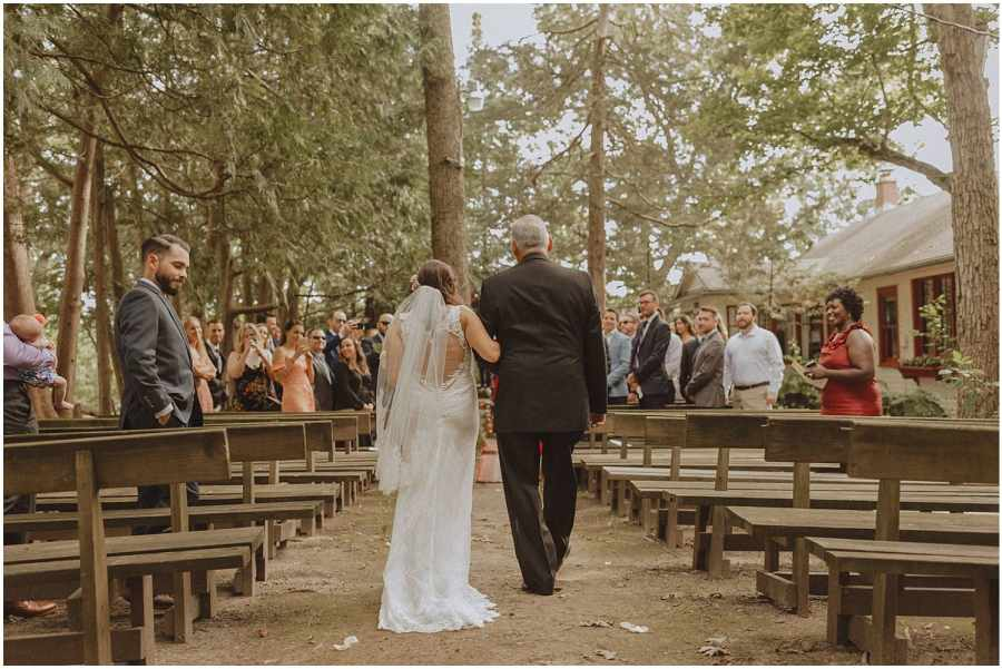 bride walking with her father down the aisle wisconsin wedding elopement photographer kyle szeto