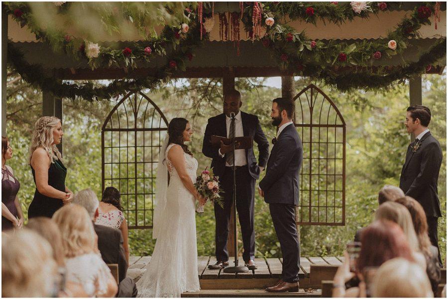 bride and groom standing during wedding ceremony wisconsin wedding elopement photographer kyle szeto