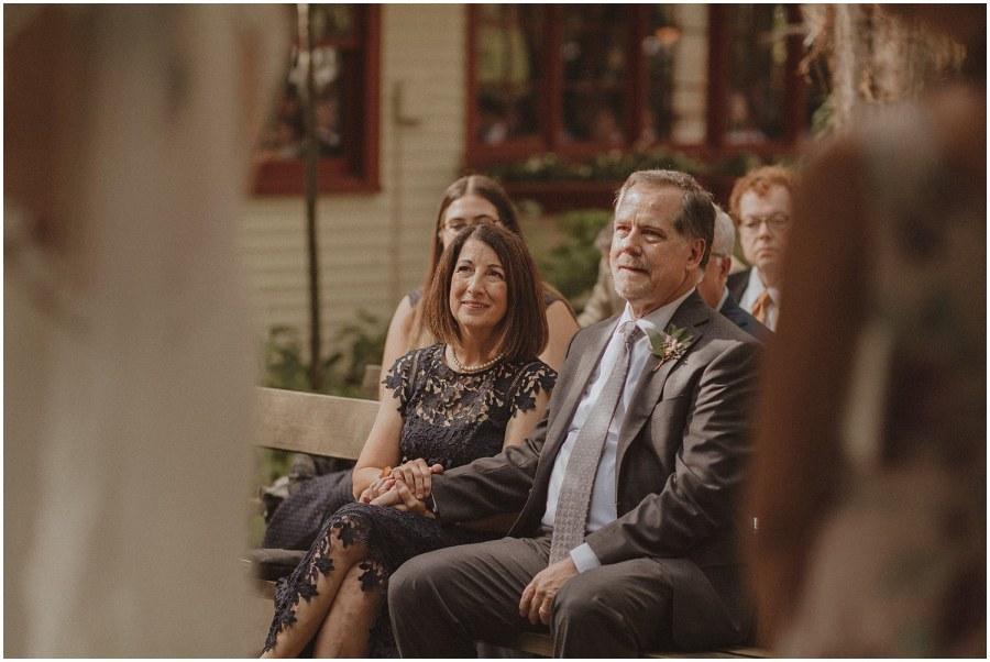 parents looking on during ceremony wisconsin wedding elopement photographer kyle szeto