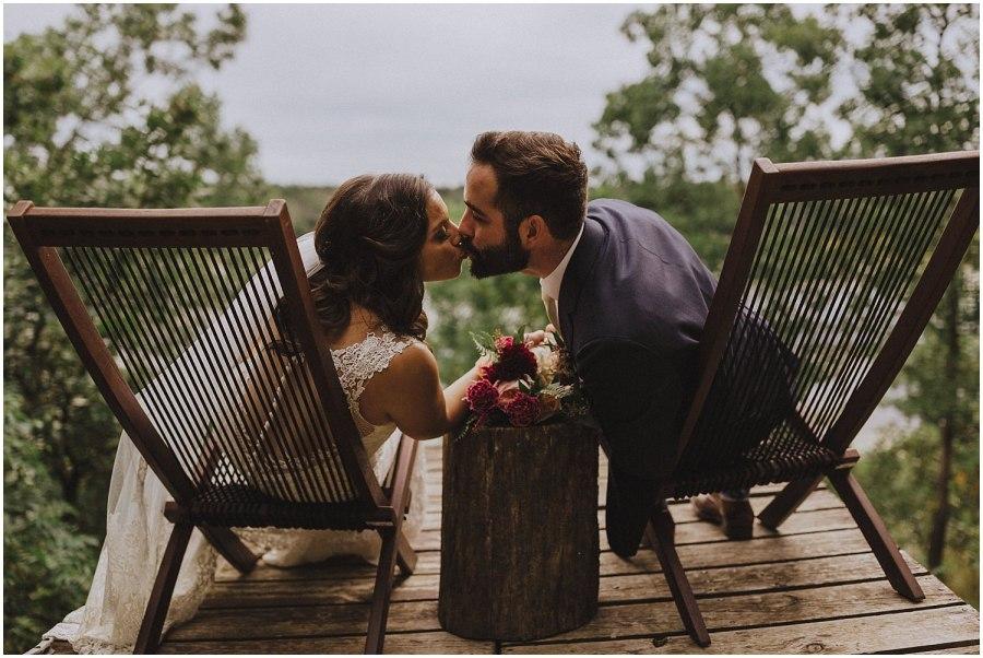 couple going for a kiss wisconsin wedding elopement photographer kyle szeto