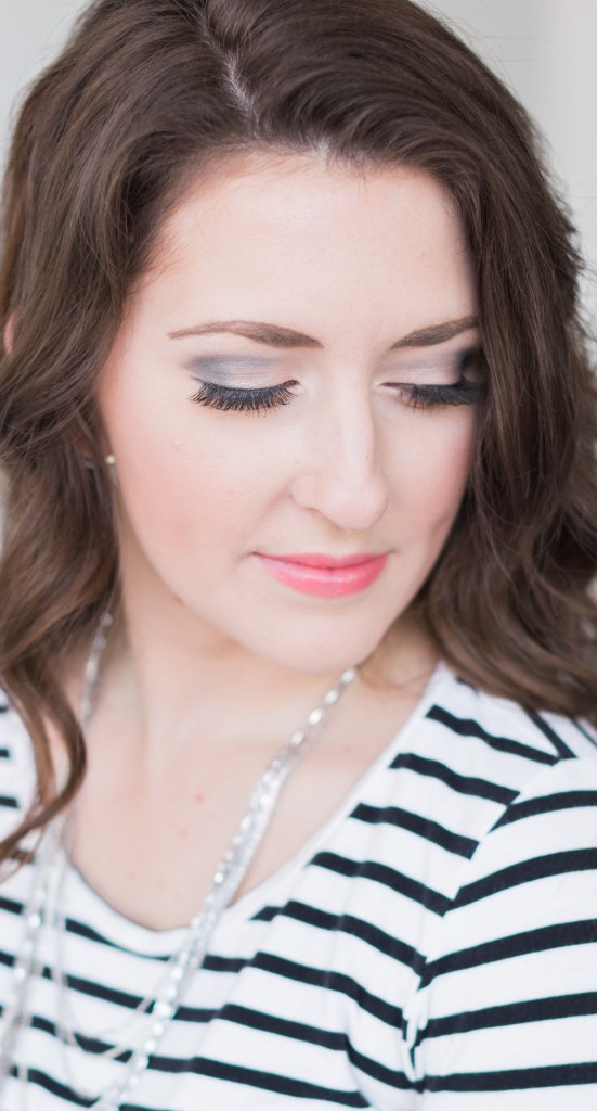 Dramatic Eye and nude lip look - this look transitions perfectly from day to night! Light contouring, defined brows, false lashes and a nude pink lip keep it flirty. A partial smoky eye adds drama but the lighter shades keep it daytime appropriate.
