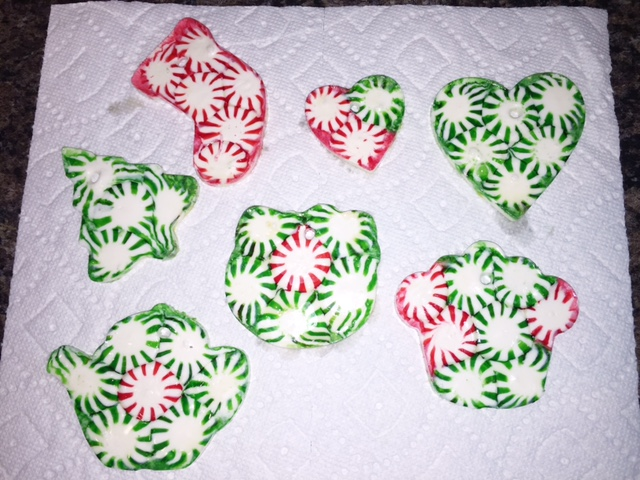 DIY Peppermint Hard Candy Ornaments - simple recipe for a quick christmas crafts that anyone can do! It's great for kids and not very messy! These DIY ornaments look great on the tree or as gift toppers!