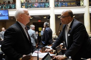 Sen. Dennis Parrett discusses legislation with Sen. Reggie Thomas during a brief recess in the Senate.