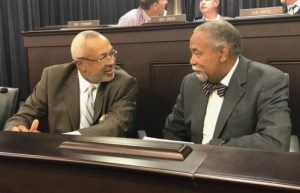 Senate Democratic Caucus Chair Gerald A. Neal confers with Rep. Arnold Simpson during the October meeting of the Interim Joint Committee on Transportation.