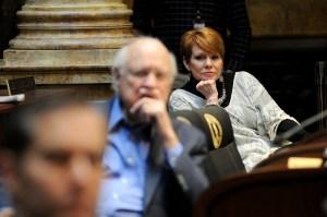 Senator Denise Harper Angel, D-Louisville (right), follows proceedings in the Kentucky Senate.