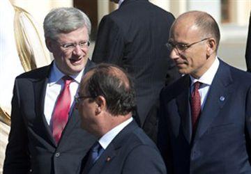 Stephen Harper, le président français François Hollande et le premier ministre italien Enrico Letta. (Photo: Adrian Wyld, PC)