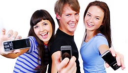 Three people holding cell phones (iStockphoto)