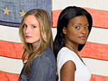 A white woman and black woman stand in front of an American flag (Getty Images)