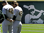 Oakland Athletics players stand on the field wearing the number 42 in tribute to hall-of-famer Jackie Robinson before a baseball game against the Chicago White Sox in Chicago, Tuesday, April 15, 2008. The entire Athletics team wore number 42 for Tuesday's game. (AP Photo/Brian Kersey)